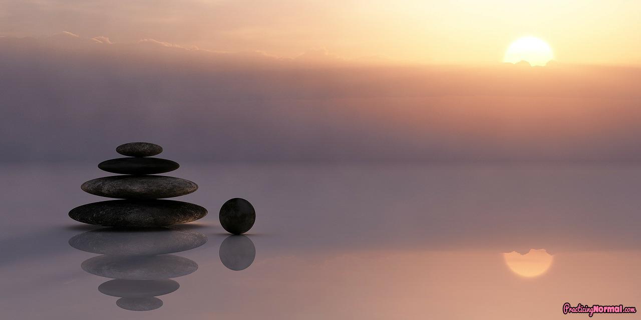 balance stone sunset  calm sea sunset